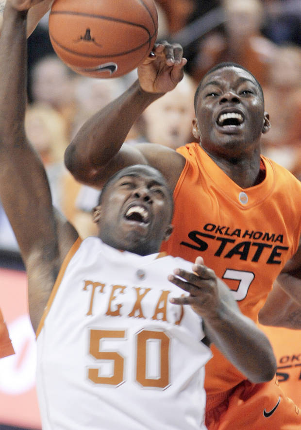 photo - Oklahoma State guard Obi Muonelo, right, pressures Texas guard J'Covan Brown. AP photo