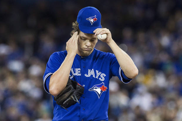 photo - Toronto Blue Jays starting pitcher Josh Johnson reacts as he works against New York Yankees during first inning of an MLB American League baseball action in Toronto on Sunday, April 21, 2013. (AP Photo\THE CANADIAN PRESS,Chris Young) ORG XMIT: CHY105