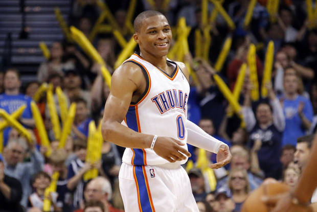 photo - Oklahoma City's Russell Westbrook (0) celebrates during the NBA game between the Oklahoma City and the Utah Jazz and the Chesapeake Energy Arena, Friday,Nov. 30, 2012. Photo by Sarah Phipps, The Oklahoman