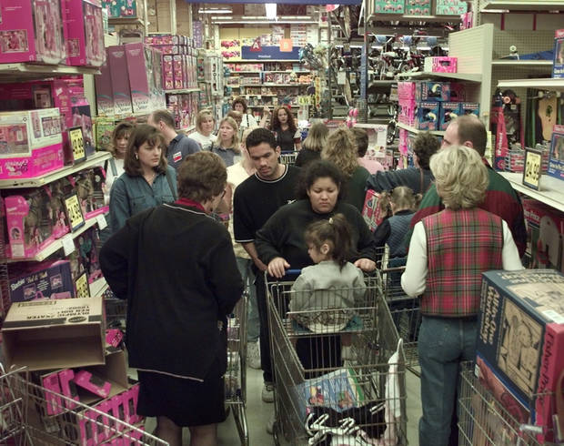 Christmas shopping: Shoppers in a log jam at Toys-R-Us at Quail Springs in 2000.