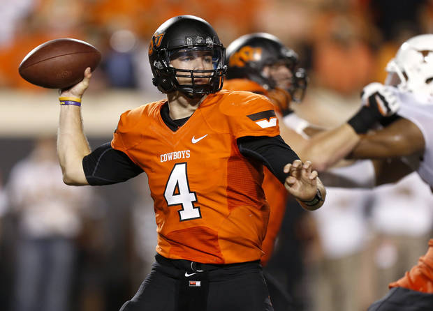 photo - Oklahoma State's J.W. Walsh (4) drops back to pass during a college football game between Oklahoma State University (OSU) and the University of Texas (UT) at Boone Pickens Stadium in Stillwater, Okla., Saturday, Sept. 29, 2012. Photo by Bryan Terry, The Oklahoman