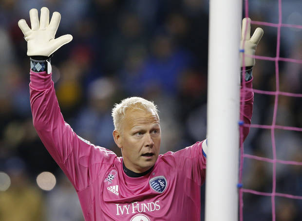 photo - Sporting KC goalkeeper Jimmy Nielsen watches a shot sail past his goal and into the crowd during the first half of an MLS soccer match against D.C. United in Kansas City, Kan., Friday, Oct. 18, 2013. (AP Photo/Orlin Wagner)