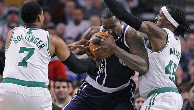 photo - Oklahoma City Thunder center Kendrick Perkins, center, is sandwiched between Boston Celtics center Jared Sullinger (7) and forward Gerald Wallace on a drive to the basket during the first quarter of an NBA basketball game in Boston, Friday, Jan. 24, 2014. (AP Photo/Charles Krupa)