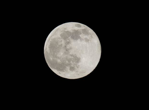 A blue moon rises Friday, July 31, 2015 as seen from Taguig city east of Manila. AP Photo