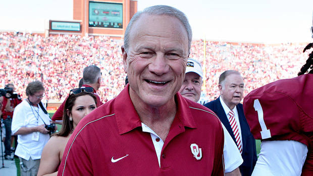 photo - Former Oklahoma Sooners Head Coach Barry Switzer walks off the field after a presentation before the game against the Louisiana-Monroe Warhawks August 31, 2013 at Gaylord Family-Oklahoma Memorial Stadium in Norman, Oklahoma. Oklahoma defeated Louisiana-Monroe 34-0. (Photo by Brett Deering/Getty Images)