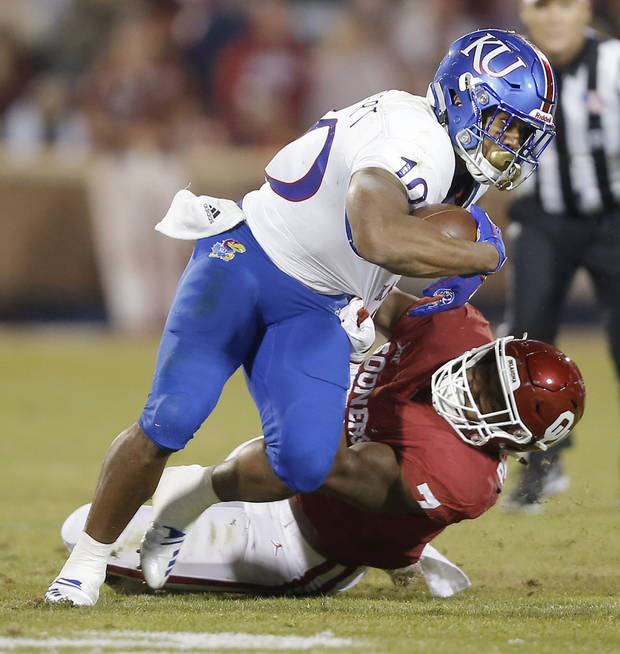 Oklahoma's Ronnie Perkins (7) brings down Kansas' Khalil Herbert (10) during a college football game between the University of Oklahoma Sooners (OU) and the Kansas Jayhawks (KU) at Gaylord Family-Oklahoma Memorial Stadium in Norman, Okla., Saturday, Nov. 17, 2018. Photo by Bryan Terry, The Oklahoman