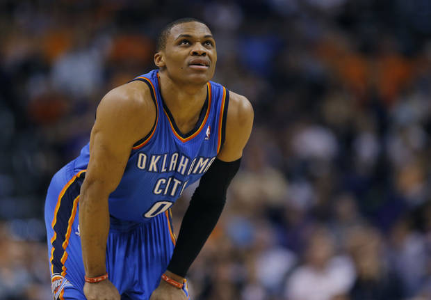 photo - Oklahoma City Thunder guard Russell Westbrook (0) looks at the scoreboard during the first half of an NBA basketball game against the Phoenix Suns on Sunday, April 6, 2014,in Phoenix. (AP Photo/Matt York)