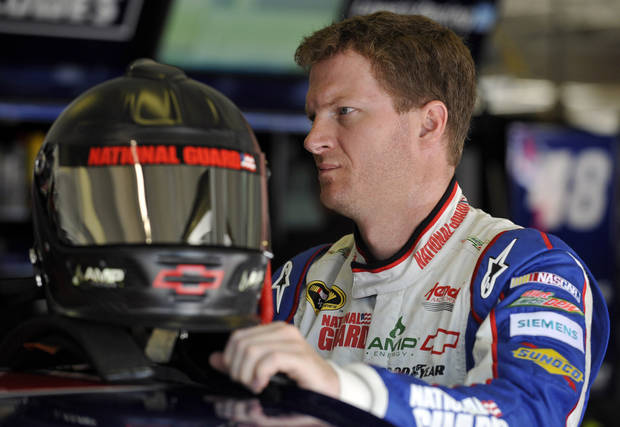 photo - Dale Earnhardt Jr. prepares to practice for Sunday's NASCAR Sprint Cup Series auto race at Atlanta Motor Speedway, Saturday, Sept. 1, 2012, in Hampton, Ga. (AP Photo/Rainier Ehrhardt)  ORG XMIT: GARE110
