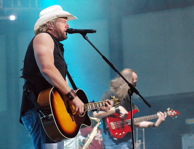 Country artist Toby Keith entertains the crowd at the Buffalo Chip Campground Monday night, Aug. 6, 2007, at the Sturgis Motorcycle Rally in Sturgis, S.D. (AP Photo/Doug Dreyer) ORG XMIT: SDDD104