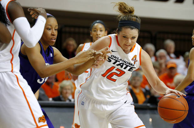 photo - Oklahoma State's Jordan Schultz (12) drives past Stephen F. Austin's LaNesha Middleton (34) during a women's college basketball game between Oklahoma State University and Stephen F. Austin at Gallagher-Iba Arena in Stillwater, Okla., Thursday, Dec. 6, 2012.  Photo by Bryan Terry, The Oklahoman