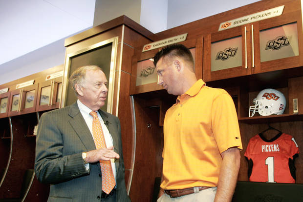 photo - OSU head coach Mike Gundy, right, talks with T. Boone Pickens in front of Pickens' locker in the recently renovated west end zone.  Photo by Steve Gooch, The Oklahoman
