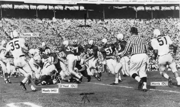 photo - OU quarterback Jay O'Neal is brought to the end of a five-yard gain by Terrapin Don Healy and a host of Maryland defenders during the first period of Monday's Orange Bowl classic. Photo taken by Joe Miller. Date photo was taken unknown. Photo was published in The Daily Oklahoman on 1-3-1956.