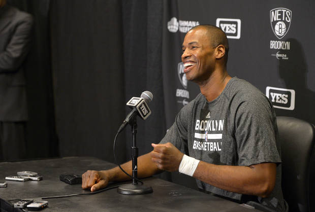 photo - Brooklyn Nets center Jason Collins speaks during a news conference prior to an NBA basketball game against the Los Angeles Lakers, Sunday, Feb. 23, 2014, in Los Angeles. Collins signed a 10-day contract with the Brooklyn Nets earlier Sunday and was to be in uniform for their game in Los Angeles against the Lakers. The 35-year-old center revealed at the end of last season he is gay, but he was a free agent and had remained unsigned. (AP Photo/Mark J. Terrill)