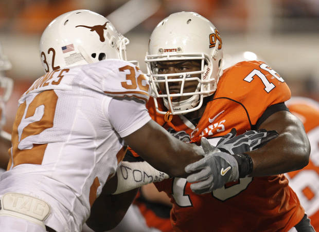 photo - Former Oklahoma State offensive lineman Russell Okung, right, is considered by some to be the prize of the coming class of offensive tackles, headed to Washington with the fourth pick or Kansas City with the fifth. AP PHOTO