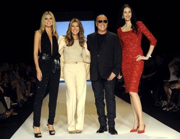 photo - Project Runway judges, left to right, Heidi Klum, Nina Garcia, Michael Kors, and Lauren Scott pose before finalists show their designs Friday, Sept. 9, 2011, during Fashion Week in New York.   (AP Photo/ Louis Lanzano)