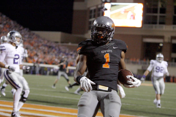 photo - CELEBRATION: Oklahoma State's Joseph Randle (1) celebrates a touchdown during a college football game between the Oklahoma State University Cowboys (OSU) and the Kansas State University Wildcats (KSU) at Boone Pickens Stadium in Stillwater, Okla., Saturday, Nov. 5, 2011.  Photo by Sarah Phipps, The Oklahoman ORG XMIT: KOD