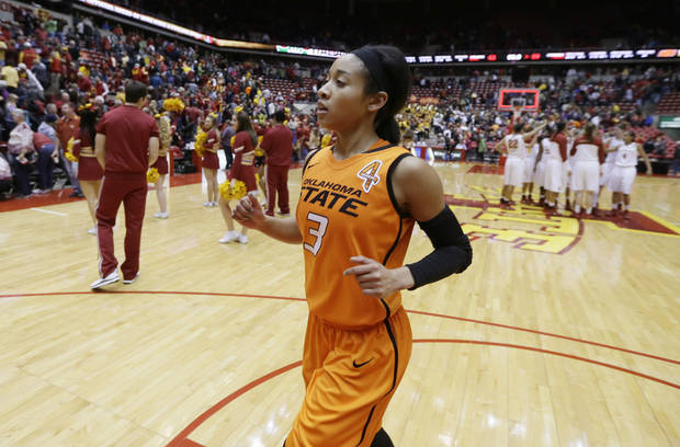 photo - Oklahoma State guard Tiffany Bias runs off the court after an NCAA college basketball game against Iowa State, Saturday, Jan. 11, 2014, in Ames, Iowa. Bias scored 22 points as Oklahoma State won 69-62. (AP Photo/Charlie Neibergall)