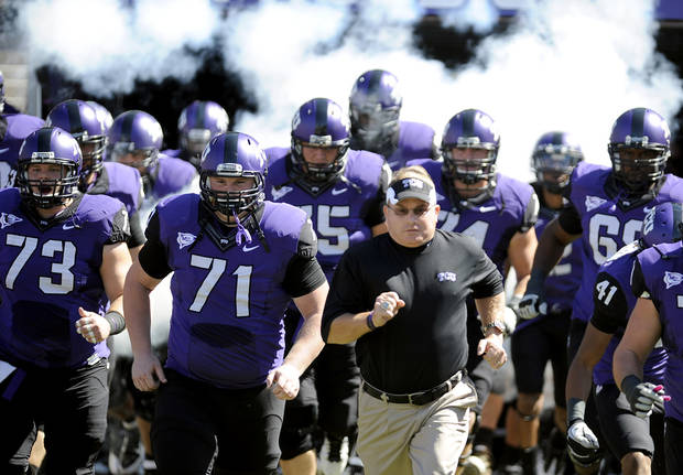 photo - In this photo taken Saturday, Oct. 1, 2011, TCU head coach Gary Patterson runs onto the field with his team before an NCAA college football game against SMU in Fort Worth, Texas. (AP Photo/Matt Strasen) ORG XMIT: NY169