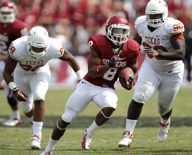 photo - OU&#039;s Dominique Whaley (8) runs past UT&#039;s Steve Edmond (33) during the Red River Rivalry college football game between the University of Oklahoma (OU) and the University of Texas (UT) at the Cotton Bowl in Dallas, Saturday, Oct. 13, 2012. Photo by Chris Landsberger, The Oklahoman