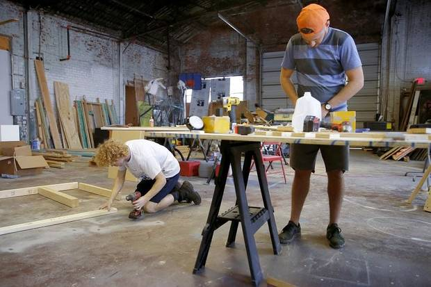 "Matt Banister, left, and Johnathan Jarmon work on Phase 2 of Factory Obscura's ""Mix-Tape"" experience at The Womb in Oklahoma City Saturday, Sept. 7, 2019. The artist collective's first permanent art experience opens Sept. 21. [Bryan Terry/The Oklahoman]"