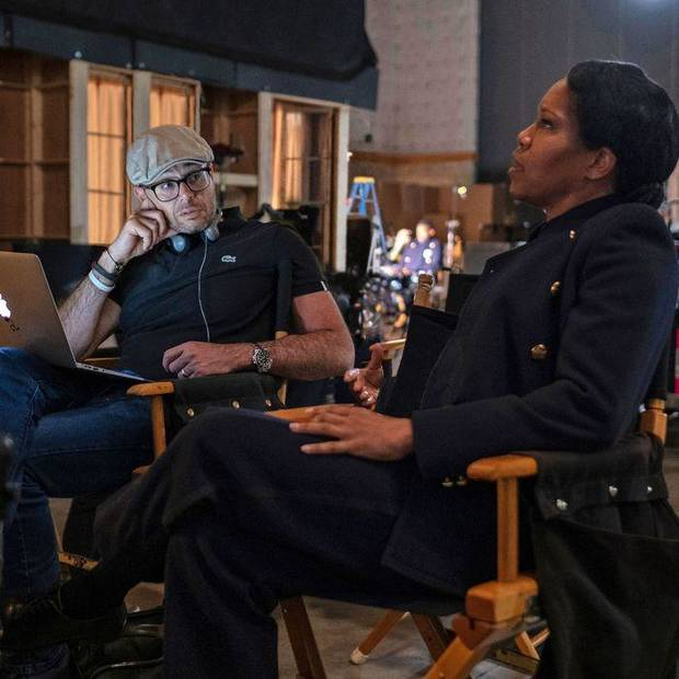 "Damon Lindelof, left, and Regina King collaborate on the set of the series ""Watchmen."" [HBO photo]"