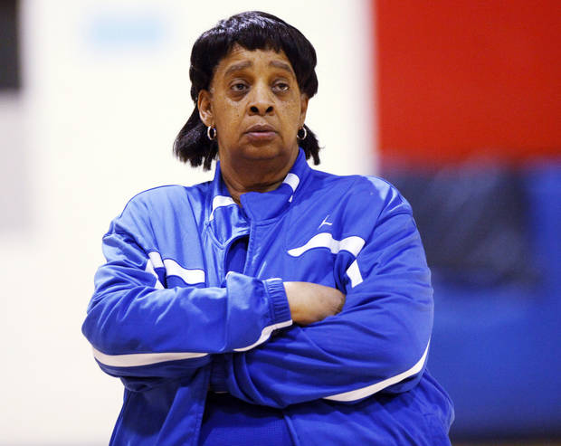 photo - Millwood basketball coach Arnelia Spears (right) watches as players run through a lay up drill during practice on Tuesday, March 11, 2014. Spears is retiring from coaching after over 40 years at Millwood. Photo by KT King, The Oklahoman