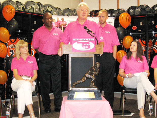 photo - Heisman Trophy winner Steve Owens, center, speaks Monday at Norman High School during the Oklahoma Students Care