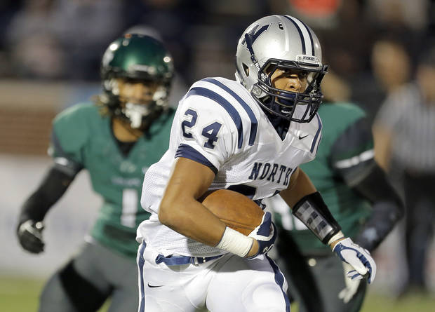 photo - Edmond North's Ezel McIntee rushes during high school football game between Edmond Santa Fe and Edmond North at Wantland Stadium in Edmond, Okla.,  Friday, Sept. 14, 2012. Photo by Sarah Phipps, The Oklahoman