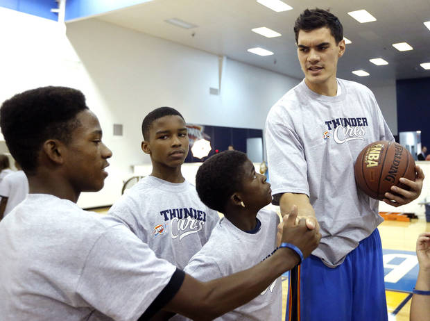 photo - OKLAHOMA CITY THUNDER NBA BASKETBALL: Steven Adams talks with youths during the Thunder Youth Basketball mini-camp following a press conference at the Thunder Events center, Saturday, July 29, 2013. Photo by Sarah Phipps, The Oklahoman