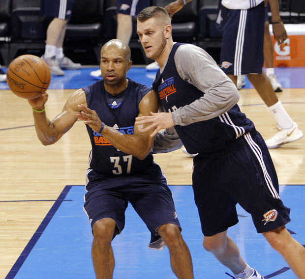photo - NBA BASKETBALL: Oklahoma City's Derek Fisher and Cole Aldrich go through drills during the NBA Finals practice day at the Chesapeake Energy Arena on Monday, June 11, 2012, in Oklahoma City, Okla. Photo by Chris Landsberger, The Oklahoman