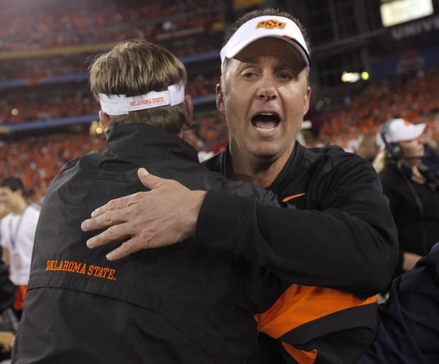 photo - COLLEGE FOOTBALL / CELEBRATION: Oklahoma State coach Mike Gundy celebrates after winning the Fiesta Bowl between the Oklahoma State University Cowboys (OSU) and the Stanford Cardinals at the University of Phoenix Stadium in Glendale, Ariz., Monday, Jan. 2, 2012. Photo by Bryan Terry, The Oklahoman