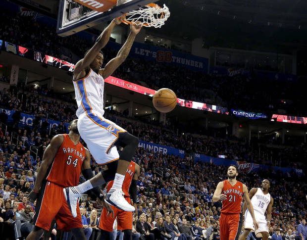 photo - Oklahoma City's Perry Jones (3) dunks the ball during an NBA basketball game between the Oklahoma City Thunder and the Toronto Raptors at Chesapeake Energy Arena in Oklahoma City, Sunday, Dec. 22, 2013. Oklahoma City won 107-95. Photo by Sarah Phipps, The Oklahoman