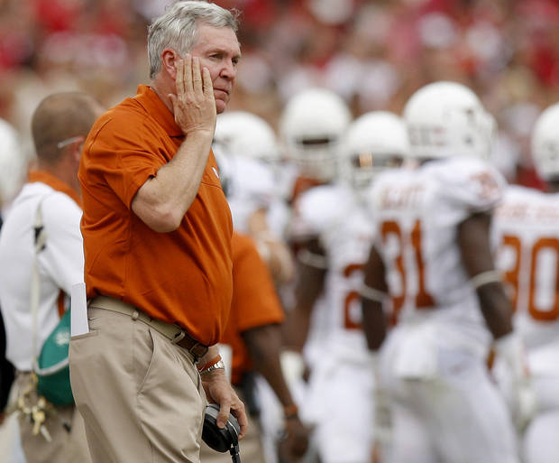 photo - REACTION: Texas coach Mack Brown reacts during the Red River Rivalry college football game between the University of Oklahoma (OU) and the University of Texas (UT) at the Cotton Bowl in Dallas, Saturday, Oct. 13, 2012. Oklahoma won 63-21. Photo by Bryan Terry, The Oklahoman
