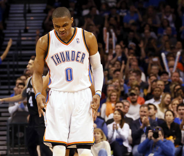 photo - Oklahoma City's Russell Westbrook (0) reacts after hitting a 3-point shot during an NBA basketball game between the Oklahoma City Thunder and the San Antonio Spurs in Oklahoma City Monday, Dec. 17, 2012. Photo by Nate Billings, The Oklahoman
