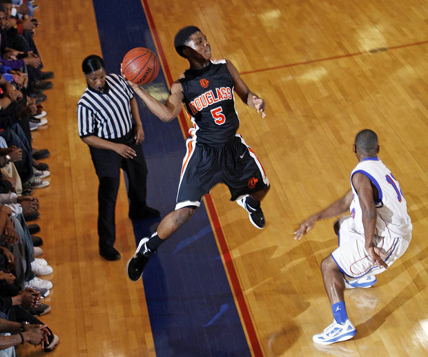 photo - Stephen Clark (5) of Douglass saves the ball from going out-of-bounds during a boys high school basketball game between Douglass and Millwood at the Millwood Field House in Oklahoma City, Friday, Jan. 13, 2012. Photo by Nate Billings, The Oklahoman