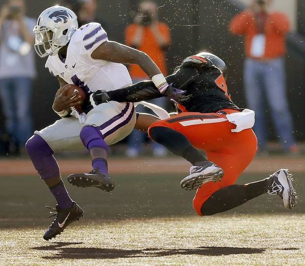 photo - Oklahoma State's defense forced five turnovers against Kansas State in a 33-29 win Saturday in Stillwater.