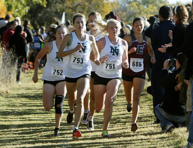 photo - The Norman North team stays together during the first part of the 6A Girl's race, during the Classes 6A, 5A & 4A State Cross country meet at Edmond Santa Fe High School in Edmond, OK, Saturday, November 2, 2013,  Photo by Paul Hellstern, The Oklahoman