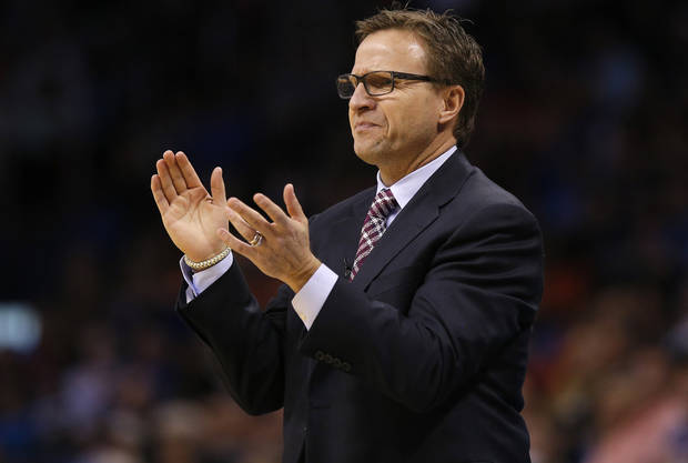 photo - Oklahoma City coach Scott Brooks claps during an NBA basketball game between the Oklahoma City Thunder and the Golden State Warriors at Chesapeake Energy Arena in Oklahoma City, Friday, Jan. 17, 2014. Oklahoma City won 127-121. Photo by Bryan Terry, The Oklahoman