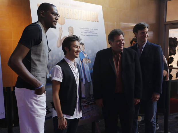 photo - Kevin Durant, Taylor Gray, Director John Whitesell, and Producer Mike Karz pose for photos during the red carpet premiere of Thunderstruck at Harkins Bricktown Theatre in Oklahoma City, Sunday, Aug. 19, 2012.  Photo by Garett Fisbeck, For The Oklahoman