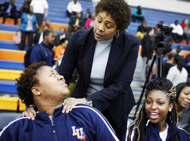 photo - Women's basketball great Cheryl Miller speaks to players Alex Adekunle (left) and Kashyla Fields (right) before the beginning of a press conference where she was introduced as the head coach of Langston's women's basketball program on Tuesday, April 29, 2014 Photo by KT King, The Oklahoman