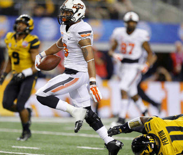 photo - Oklahoma State's Josh Stewart (5) scores a touchdown past Missouri's Aarion Penton (11) during the AT&T Cotton Bowl Classic college football game between the Oklahoma State University Cowboys (OSU) and the University of Missouri Tigers at AT&T Stadium in Arlington, Texas, Friday, Jan. 3, 2014. Photo by Bryan Terry, The Oklahoman