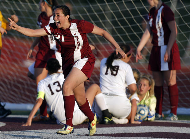 photo - Putnam City North's Karla Cabello celebrates Putnam City North's win at high school soccer game between Edmond Memorial and Putnam City North and Edmond Memorial High School in Edmond, Okla., Tuesday, April 30, 2013. Photo by Sarah Phipps, The Oklahoman