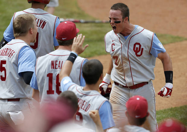 photo - Oklahoma's Max White reacts after scoring against Kansas State in the seventh inning of a Big 12 Championship tournament game at the Chickasaw Bricktown Ballpark in Oklahoma City, Saturday, May, 25, 2013. Oklahoma won 7-6. Photo by Bryan Terry, The Oklahoman