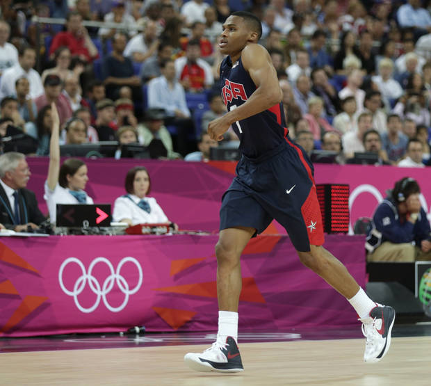 photo - United States' Russell Westbrook hobbles off the court as he leaves the game against Argentina during a men's semifinals basketball game at the 2012 Summer Olympics, Friday, Aug. 10, 2012, in London. (AP Photo/Charles Krupa) ORG XMIT: OBKO149