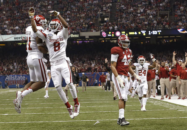 photo - Oklahoma's Lacoltan Bester (11) and Jalen Saunders (8) celebrate a touchdown in front of Alabama's Adrian Hubbard (42) during the NCAA football BCS Sugar Bowl game between the University of Oklahoma Sooners (OU) and the University of Alabama Crimson Tide (UA) at the Superdome in New Orleans, La., Thursday, Jan. 2, 2014.  .Photo by Sarah Phipps, The Oklahoman