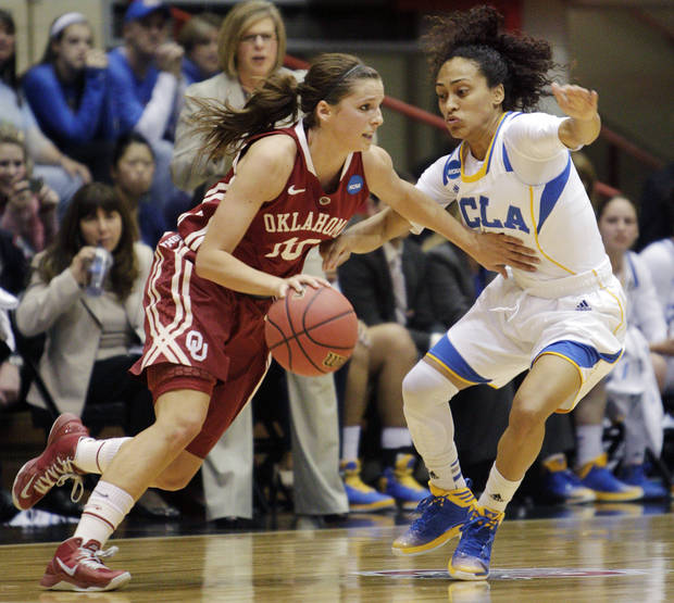 photo - Oklahoma's Morgan Hook, left, dribbles upcourt as UCLA's Mariah Williams defends during the first half of a second-round game in the women's NCAA college basketball tournament, Monday, March 25, 2013, in Columbus, Ohio. (AP Photo/Jay LaPrete) ORG XMIT: OHJL104