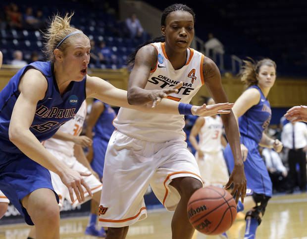 photo - Oklahoma State's Toni Young, right, and DePaul's Katherine Harry (51) chase a loose ball during the second half of a first-round game in the women's NCAA college basketball tournament in Durham, N.C., Sunday March 24, 2013. Oklahoma State won 73-56. (AP Photo/Gerry Broome) ORG XMIT: NCGB119