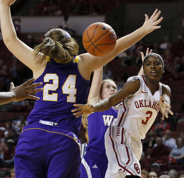 photo - OU's Aaryn Ellenberg (3) passes the ball around Western Illinois' Marley Hall (24) and Rebecca Henricson (15) during an NCAA women's basketball game between the University of Oklahoma and Western Illinois at the Lloyd Noble Center in Norman, Okla., Wednesday, Dec. 4, 2013. Photo by Bryan Terry, The Oklahoman