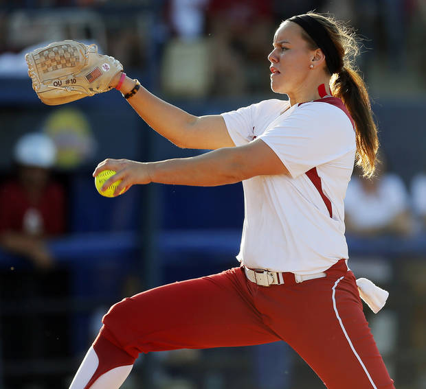 photo - OU's Keilani Ricketts (10) pitches during Game 1 of the Women's College World Series NCAA softball championship series between Oklahoma and Tennessee at ASA Hall of Fame Stadium in Oklahoma City, Monday, June 3, 2013. Photo by Nate Billings, The Oklahoman
