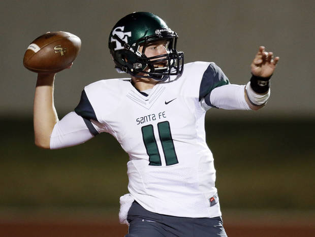 photo - Edmon Santa Fe quarterback Justice Hansen (11) passes during a high school football game between Yukon and Edmond Santa Fe in Yukon, Okla., Friday, Sept. 7, 2012. Photo by Nate Billings, The Oklahoman